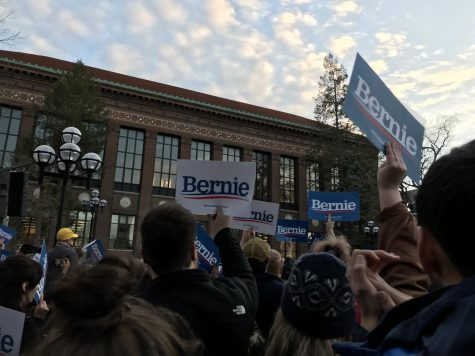 Supports cheer as Bernie Sanders brings up his plans to key issues.